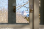 New London Ledge Light seen through an elegant glassed in room of the mansion.